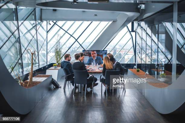 business team having video call with their manager - virtual meeting stock pictures, royalty-free photos & images