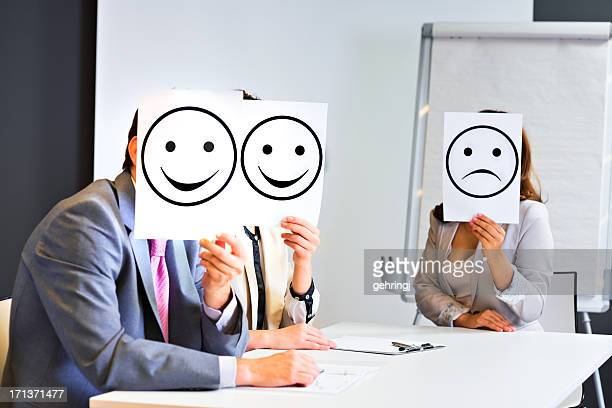 Business team holding different  signs