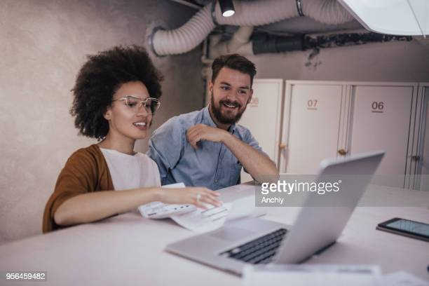 business team improving company's crm system - ginger banks stock photos and pictures