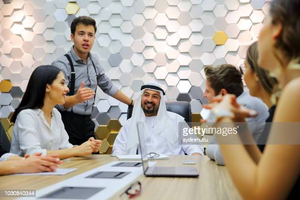 business team in a meeting - middle east stock pictures, royalty-free photos & images