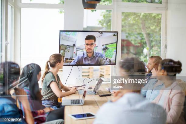 business team in video conference meeting - webinar stock photos and pictures