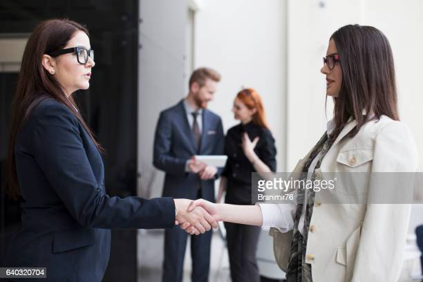 Business team joining hands-hand shake
