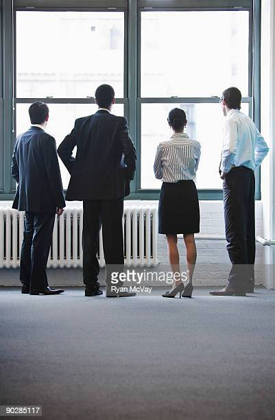 Business team looking out window