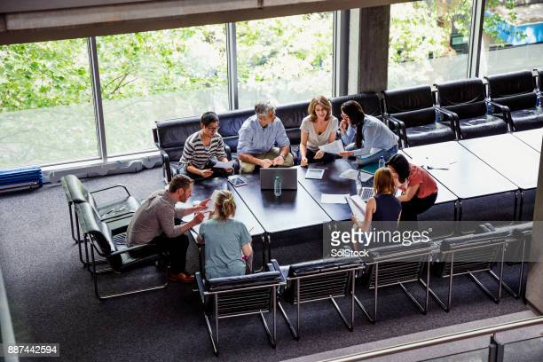 business team making plans together - english stock photos and pictures