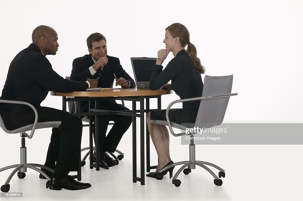 Business team meeting and using laptop : Stockfoto