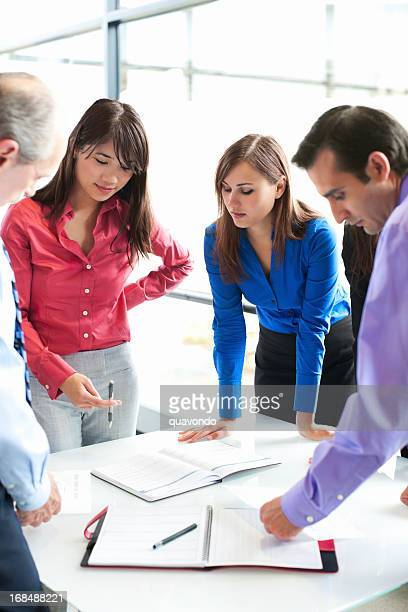 business team meeting over calendar in glass office, copy space - multi colored suit stock pictures, royalty-free photos & images