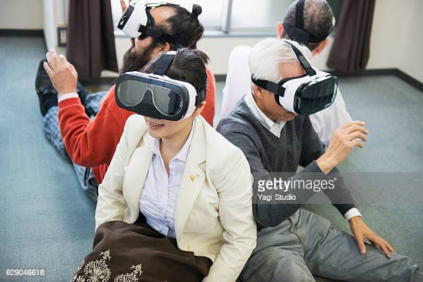 Business team meeting with VR headsetat