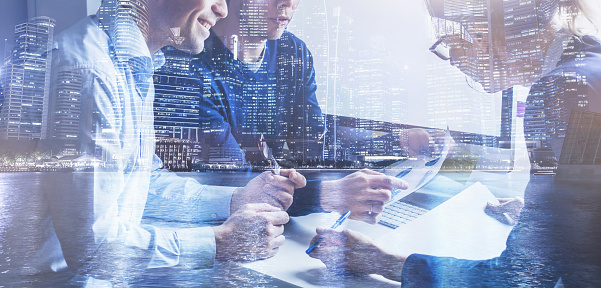 business team of coworkers working on startup in office, double exposure 1068812244