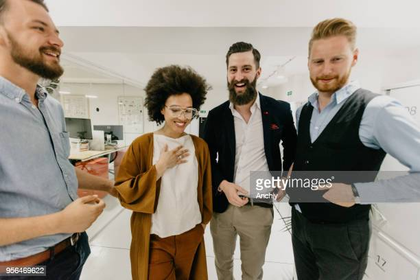 business team on a break - real estate office stock photos and pictures