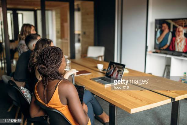 business team on a meeting - virtual meeting stock pictures, royalty-free photos & images