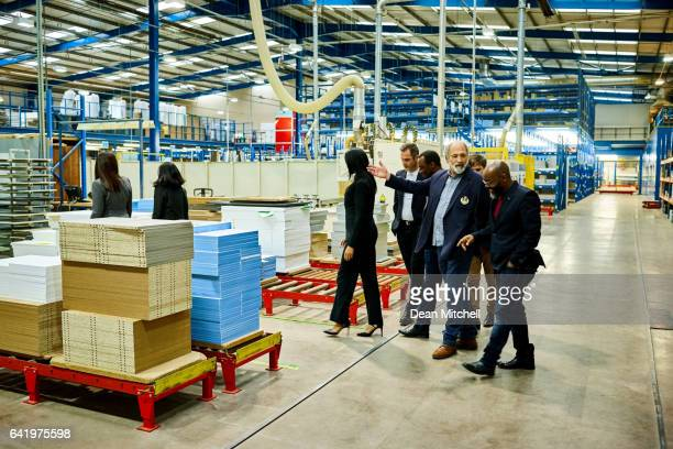 business team on a visit in plant - delegating stock photos and pictures