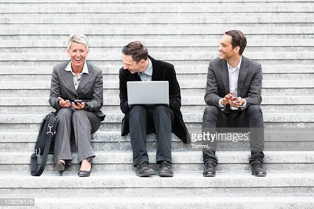 Business Team Spaß auf Treppe