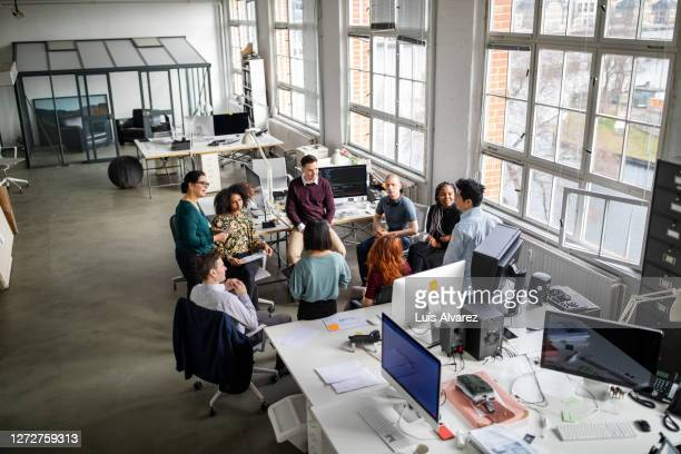 business team planning strategy in meeting - marketing stock pictures, royalty-free photos & images
