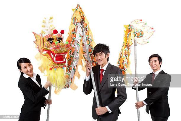 Business team practising Chinese dragon dancing