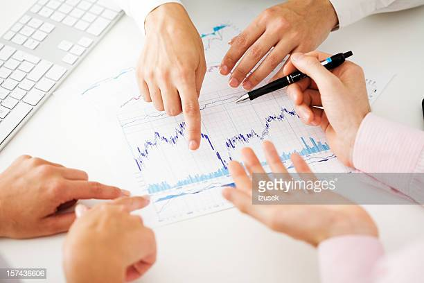 Business Team Reviewing Charts Together
