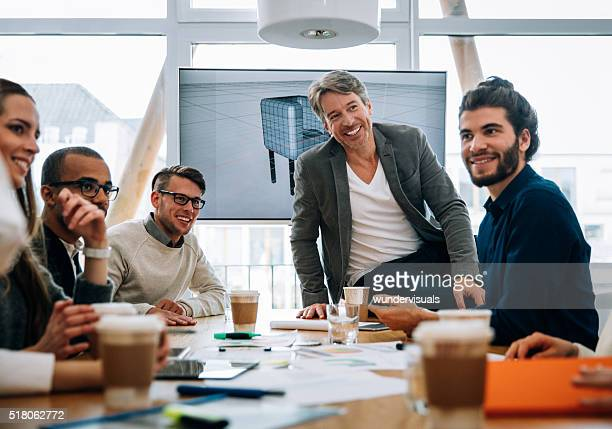 Business team smiling at colleagues after business discusion