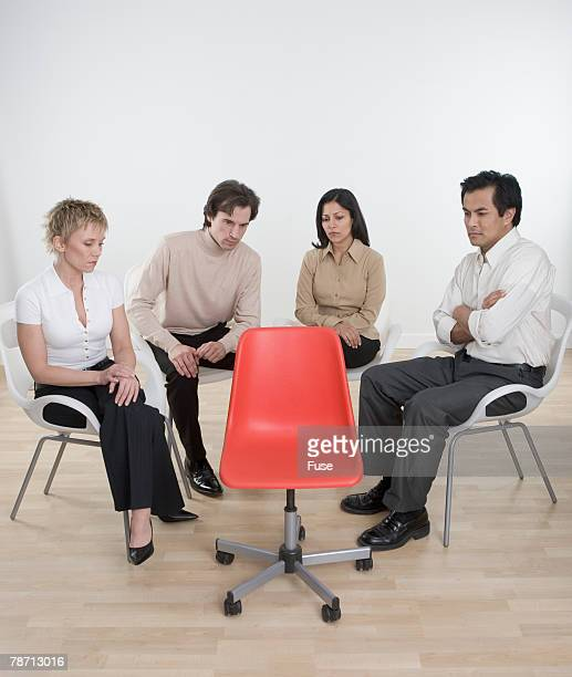 business team staring at empty chair - inconvenience stock pictures, royalty-free photos & images