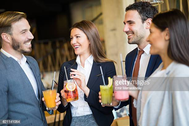 business team taking a break and drinking healthy smoothies - work party stock pictures, royalty-free photos & images