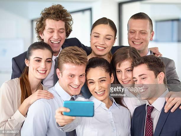 Business team taking selfie