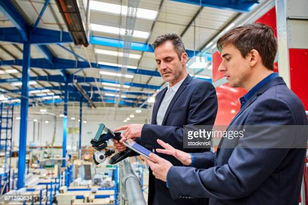 Business team testing a cctv camera at factory warehouse