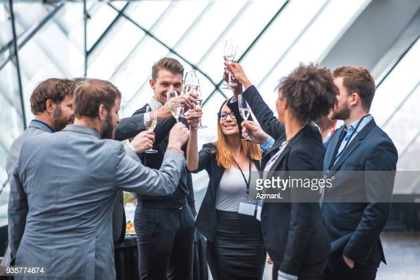 Business team toasting during a break