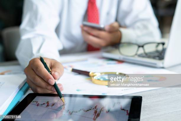 business team two colleagues working with computer, digital tablet, discussing and analysis graph stock market trading with stock chart data, financial and investment concept. - forex trading stock pictures, royalty-free photos & images