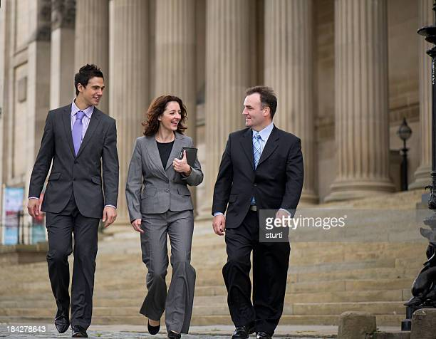 business team walking - town hall stock pictures, royalty-free photos & images