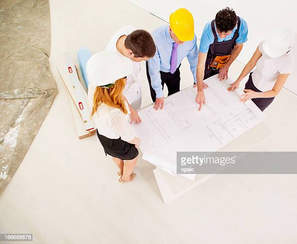 Business Team With Blueprint
