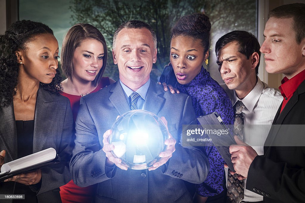 Business Team with Crystal Ball : Stock Photo