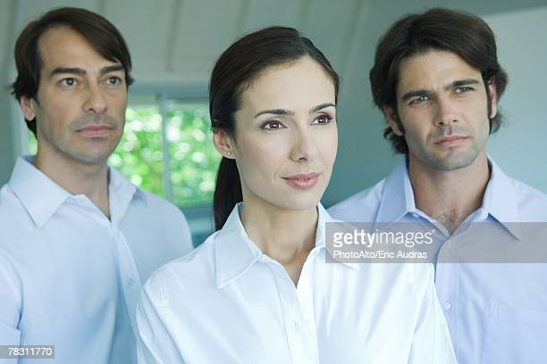 business team, woman in foreground, looking out of frame, head and shoulders - out of frame stock pictures, royalty-free photos & images