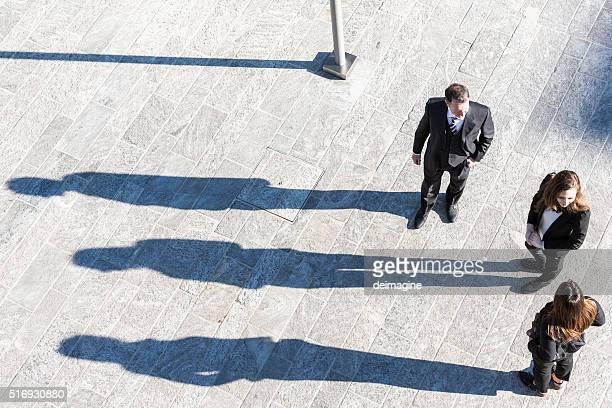 business-team-arbeit-konzept - schlagschatten stock-fotos und bilder