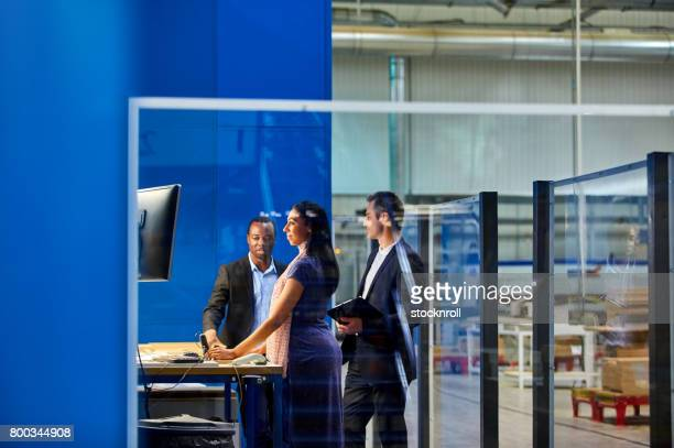 Business team working in factory