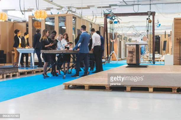 business team working - exhibition stock pictures, royalty-free photos & images