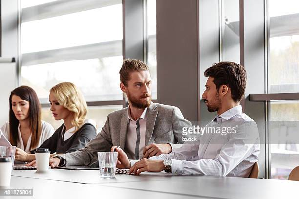 business team working together in board room - izusek stock pictures, royalty-free photos & images
