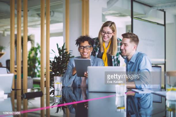 business team working together - trainee stock pictures, royalty-free photos & images