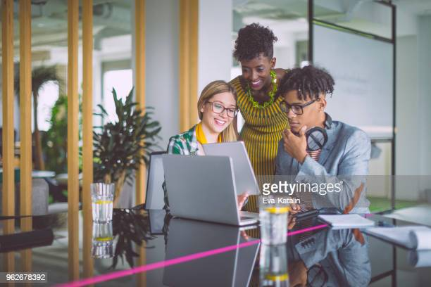 business team working together - millennial generation stock pictures, royalty-free photos & images
