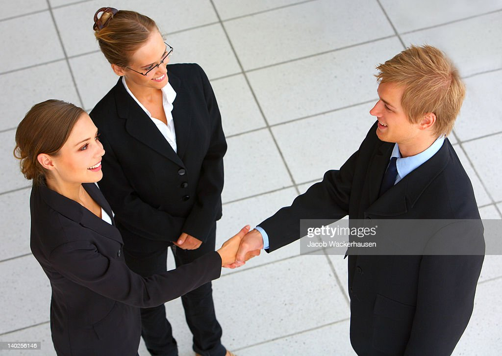Business team wrapping up a meeting with handshake : Stock Photo