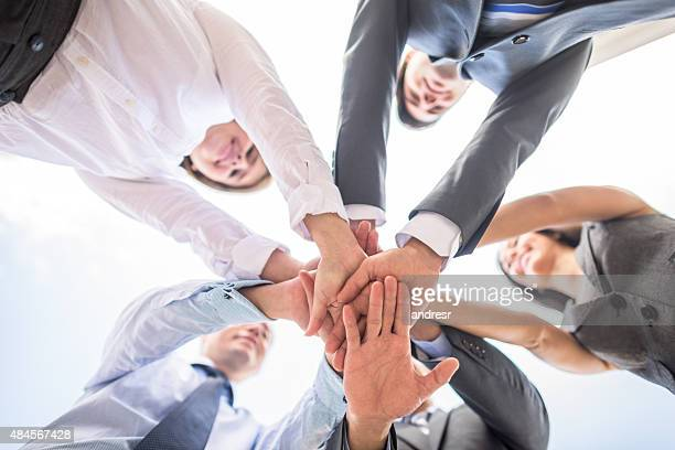 business teamwork - mid section stock photos and pictures