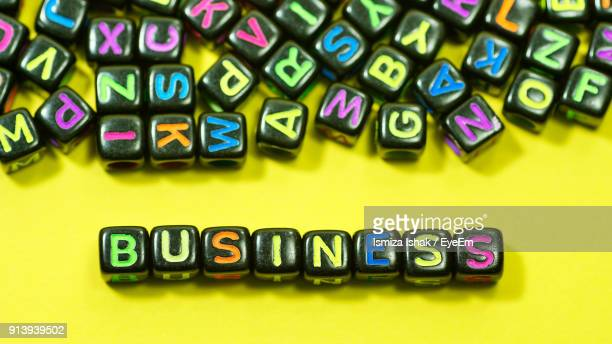 Business Text With Colorful Alphabet Blocks On Yellow Background