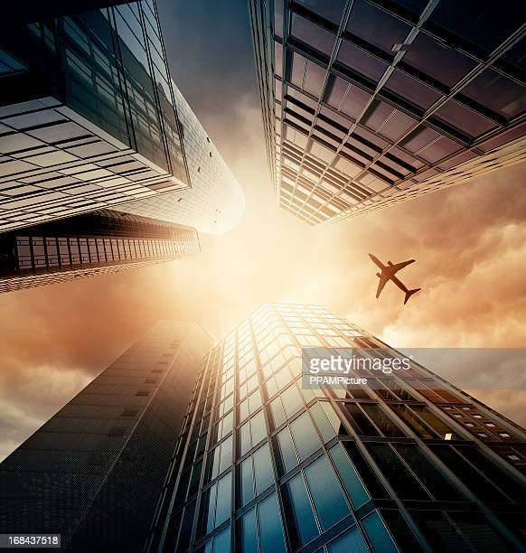 Business towers with a airplane silhouette