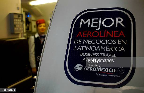 A Business Travel Awards 2011 sign is displayed on the exterior of a Grupo Aeromexico SAB plane at the Comalapa International Airport in Comalapa El...