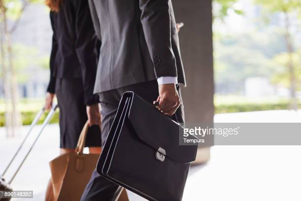business travel detail of briefcase and suitcase. - briefcase stock photos and pictures