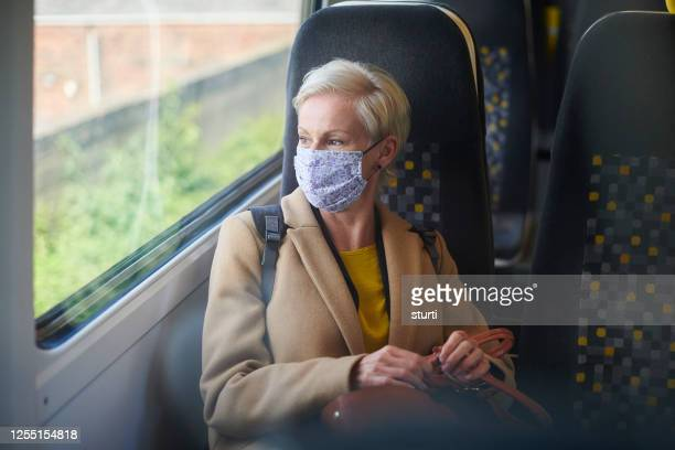 business travel with face masks - coronavirus stock pictures, royalty-free photos & images