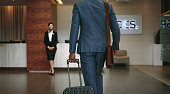 Business traveler arriving at hotel