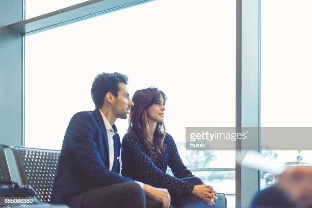 Business travelers waiting for their flight at airport