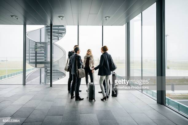 Business Travellers Standing in a group at the airport