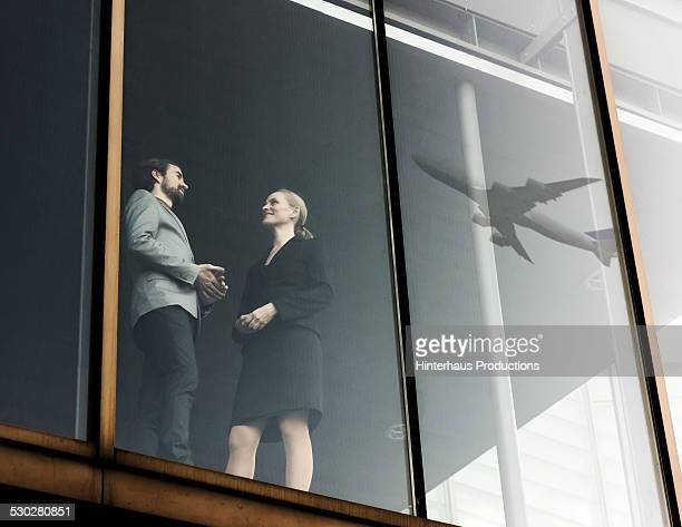 Business Travellers With Airplane Reflecting