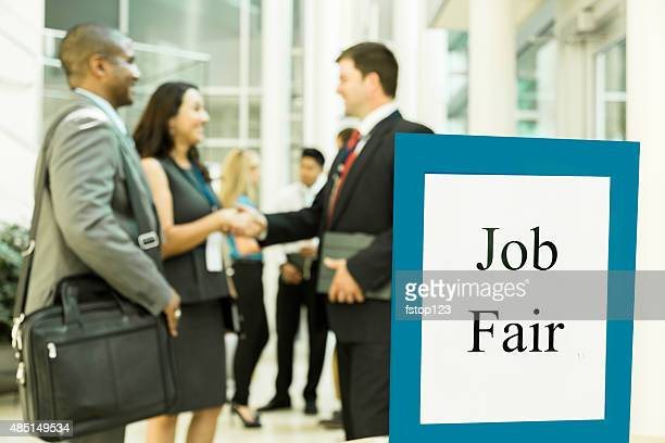 business: unemployed professionals attend a local job fair. - job fair stock pictures, royalty-free photos & images