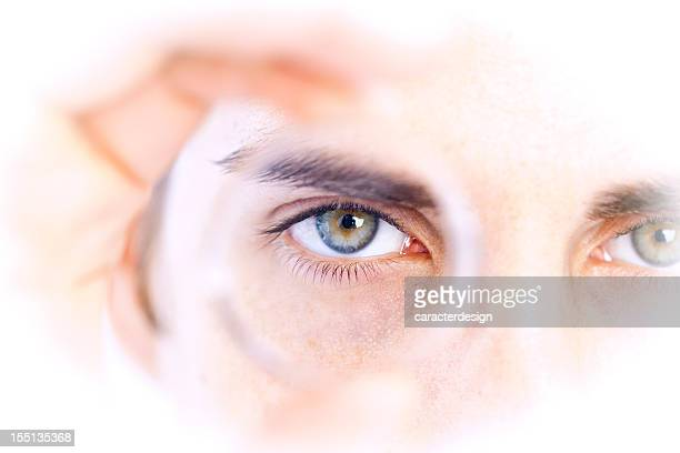 business vision: looking through a lens - lens eye stock photos and pictures