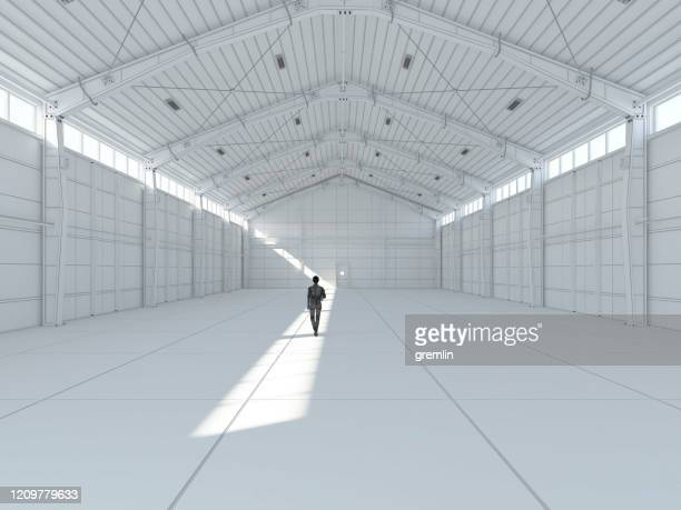 business walking in wire-frame model of empty office - wire frame model stock pictures, royalty-free photos & images